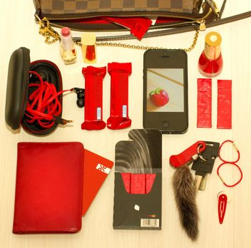 set in red tones: headphones, lipstick, telephone, chocolates, license, passport, map, elastic, barrette - Free image #342475