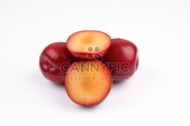 Red plums isolated on white - Free image #343555
