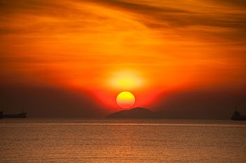 orange sunset on the sea - image #344045 gratis