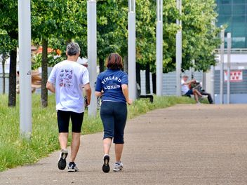 Rear view of senior couple jogging in park - image #344565 gratis