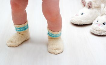 Legs of child in warm socks - image #346965 gratis