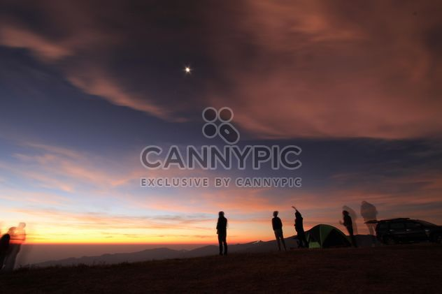 Silhouette of tourists in mountains at sunset - Free image #346985