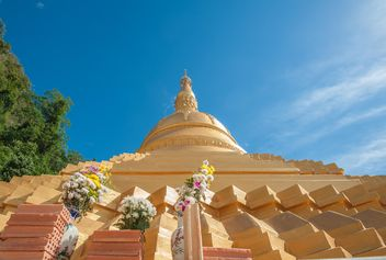 Thai temple against blue sky, view from below - бесплатный image #347195