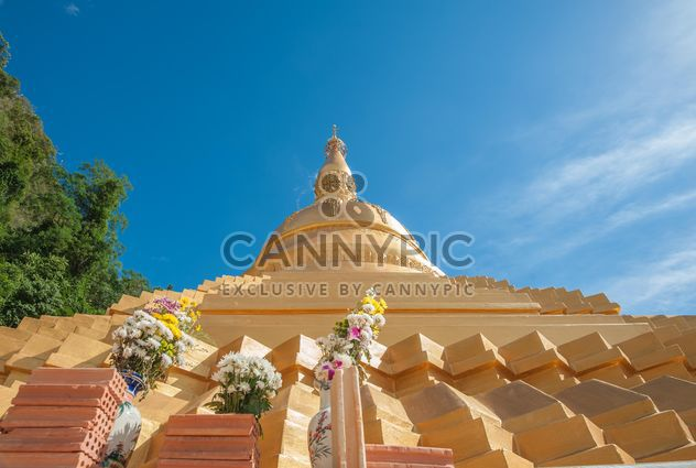 Thai temple against blue sky, view from below - Free image #347195