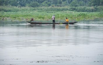 Fishermen in fishing boat on river - бесплатный image #347285