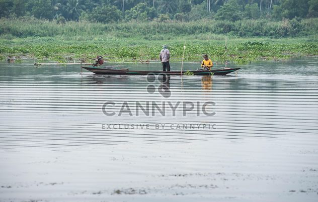 Fishermen in fishing boat on river - Free image #347285
