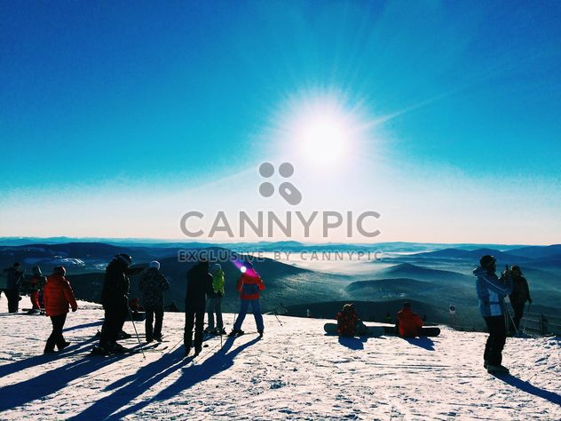 Tourists skiing in winter mountains - Free image #347705