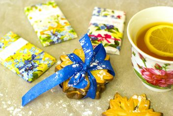 Tea with lemon, chocolate bars and cookies - image #347945 gratis