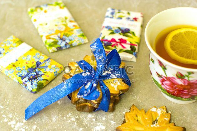Tea with lemon, chocolate bars and cookies - Free image #347945