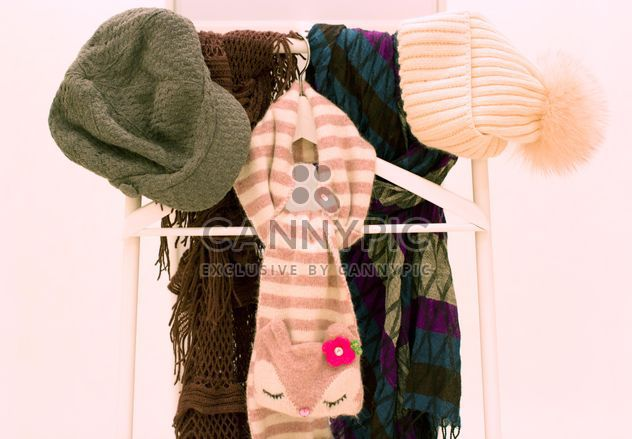 Warm scarves and hats on white background - Free image #347965