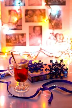 Cup of tea, book and Christmas decorations - бесплатный image #347975