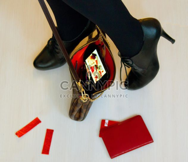 Female feet in high heel shoes with black handbag - Free image #348015
