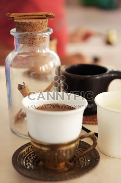 Cup of coffee and cinnamon in jar - Free image #359175