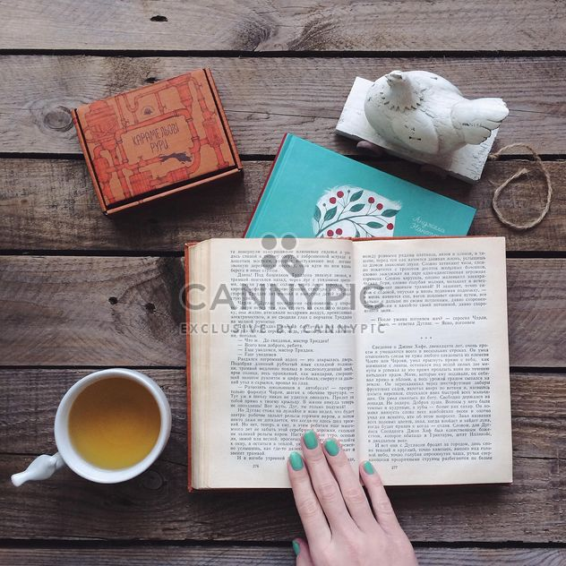 Cup of tea, candies and open book - Free image #136535