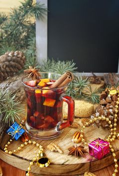mulled wine in the cup and Christmas decorations - image gratuit #136645