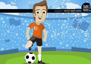 Footballplayer in field with crowd - бесплатный vector #181025