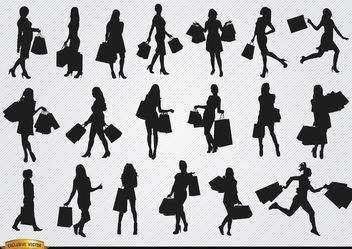 Girls with shopping bags silhouettes - vector gratuit #182385