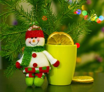 Christmas snowman, cup of tea and fir branch - image #182625 gratis