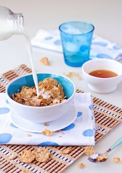 Cereals and milk for breakfast - image #182715 gratis