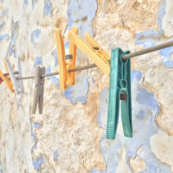 colorful clothespins hanged against wall - бесплатный image #183145