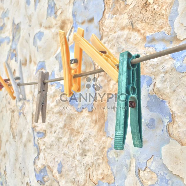 colorful clothespins hanged against wall - Free image #183145