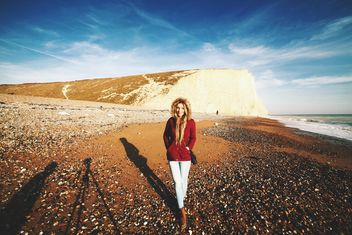 Cute girl in autumn clothes with Beachy Head - бесплатный image #183635