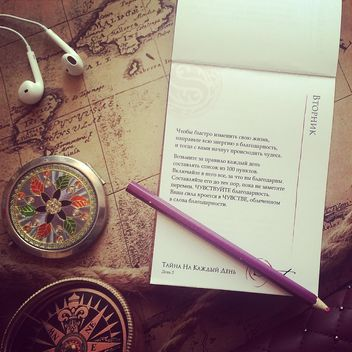 Notebook, pencil, earphones on the map - бесплатный image #183675