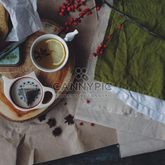 Cup of tea, rowan berries and napkins - Free image #183825
