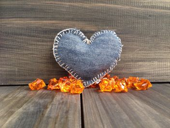 Denim heart on wooden background - бесплатный image #183885