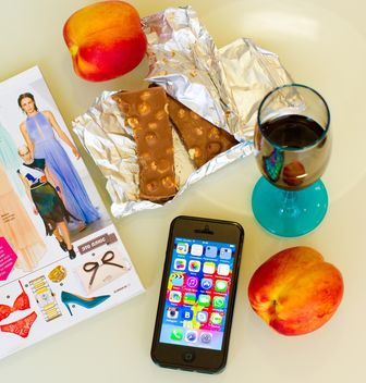 Chocolate, peaches, glass of drink and smartphone - image #186005 gratis