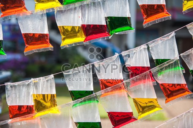 Colored water in plastic packages - Free image #186395