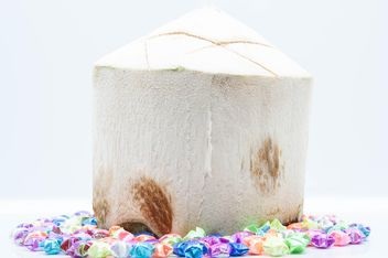 Young coconut and decorations on white background - image gratuit #186565