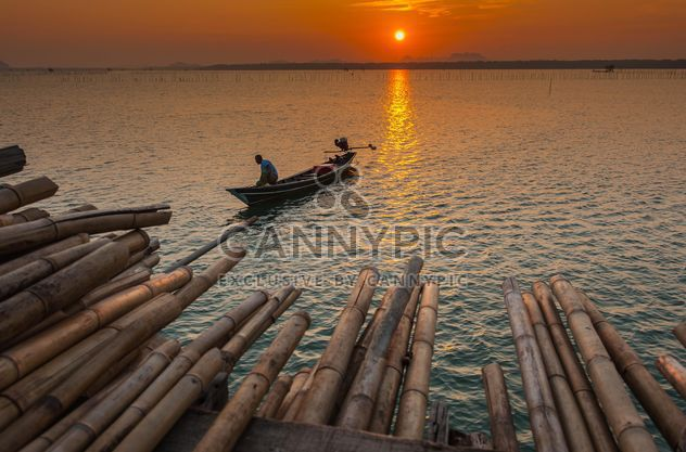 Fisherman in boat on sea - Free image #186595