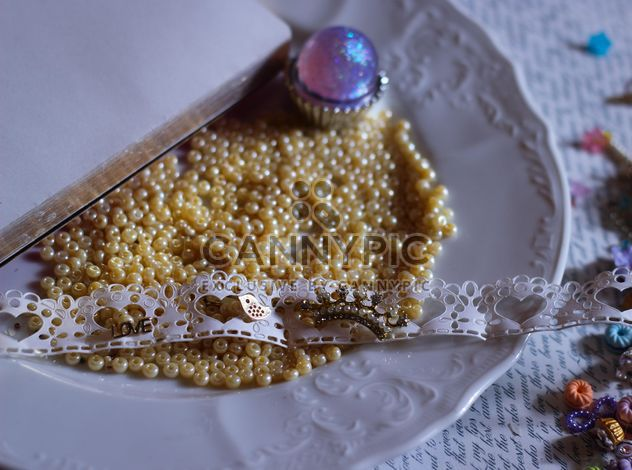 yellow beads in white plate - Free image #187285