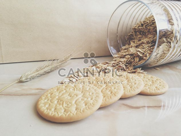 cookies and glass bank with oatmeal - Free image #198715