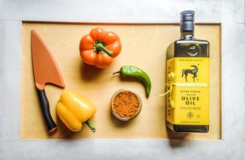 Olive oil, peppers and knife on wooden background - Free image #198935
