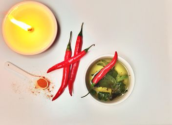 Cup of tea, chili and candle - image gratuit #198945