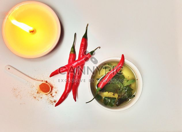 Cup of tea, chili and candle - image #198945 gratis