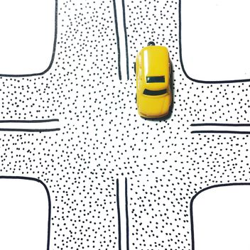 Yellow toy car on a crossroads - бесплатный image #271735