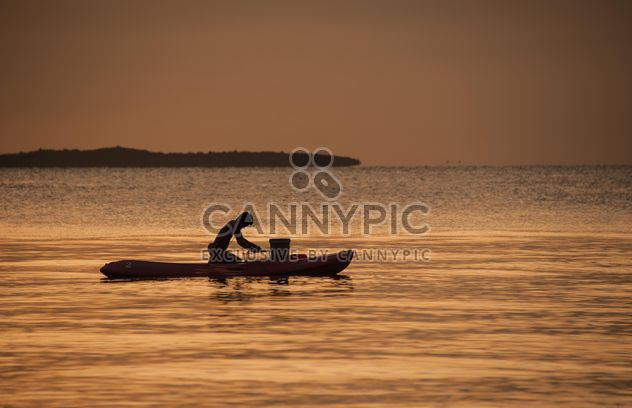 Fisherman in a boat - Free image #271825