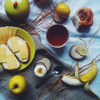 Cheese sandwiches, fruit and cup of tea - бесплатный image #272215