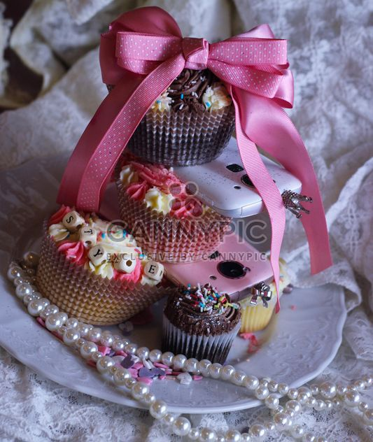 Smartphones with cupcakes - Free image #273775