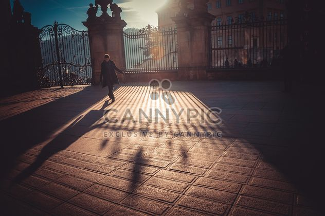 Man under sunlight in street - image #273835 gratis