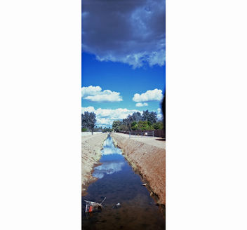 Clouds, canal, and trash bookmark - image #279535 gratis