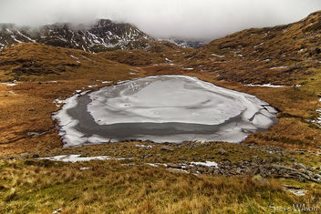 Frozen lake in Snowdonia - бесплатный image #298525