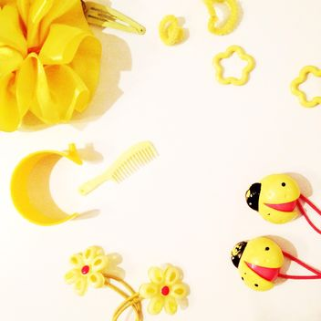 Yellow accessories over white background - image gratuit #301345