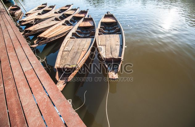 Wooden boats on a pier - image #301455 gratis