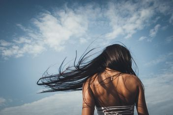Rear view of girl with flying hair - image #301565 gratis