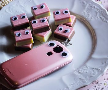 Pink smartphone with sweets - Free image #302555