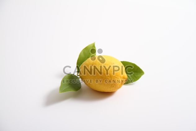 lemon with leaf on white background - Free image #302795